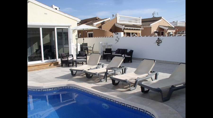 Relax on the sunbeds and cool off in the pool