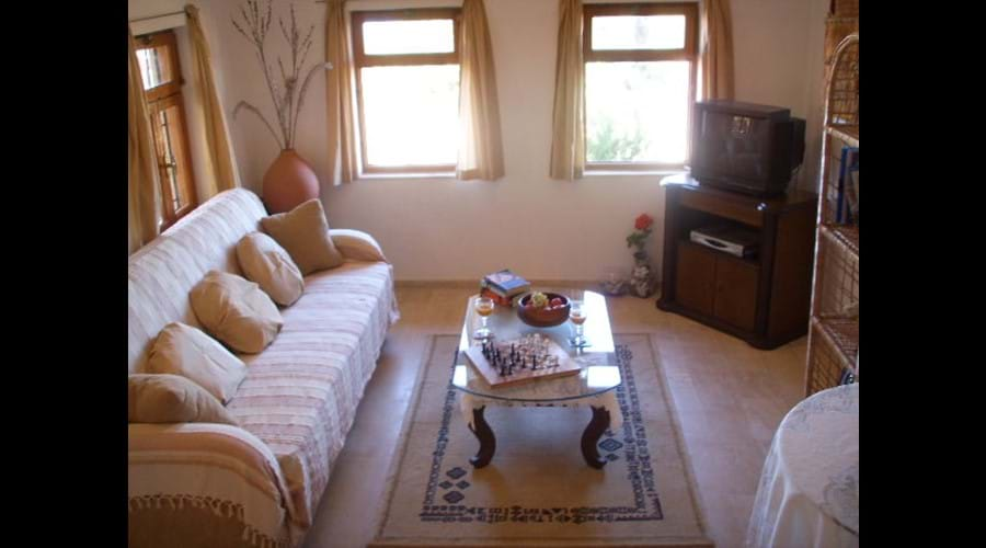 Lounge with satellite TV, DVD player and film library