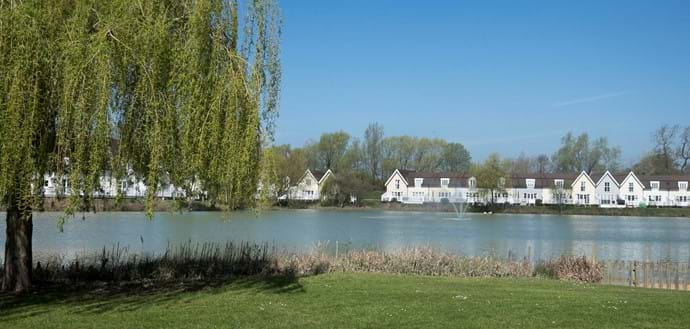 View of Elm Lodge from the opposite side of Isis lake