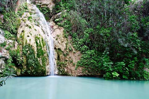 waterfall over rocks into Aphrodite baths