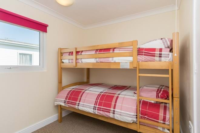 Spacious second bedroom with full size bunk beds