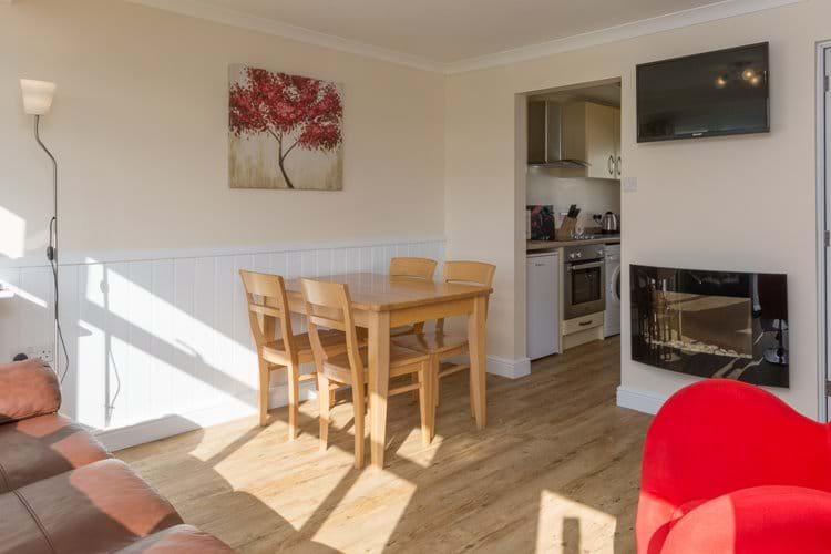 Open plan dining area with flat screen TV & feature fire