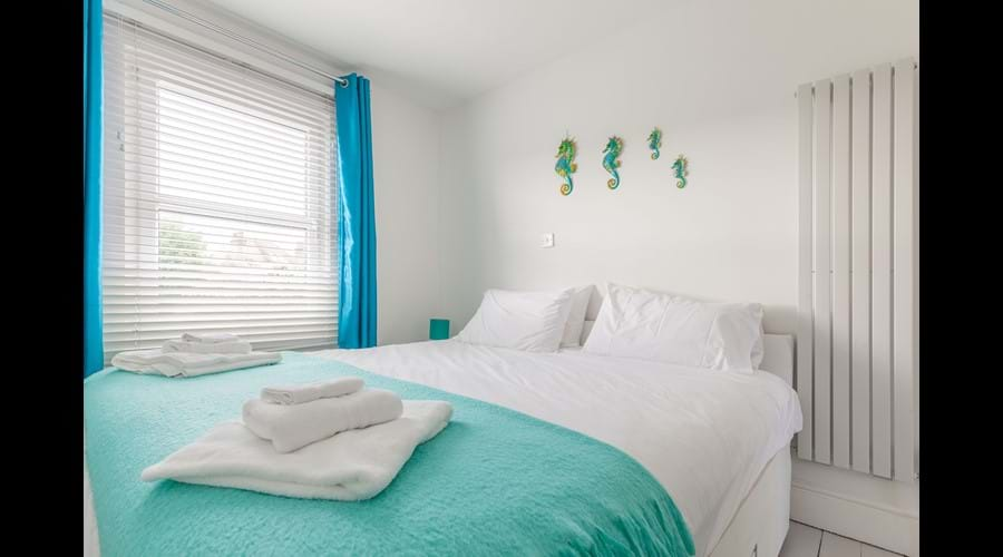 Our teal bedroom has a superking bed that can converted into twin beds