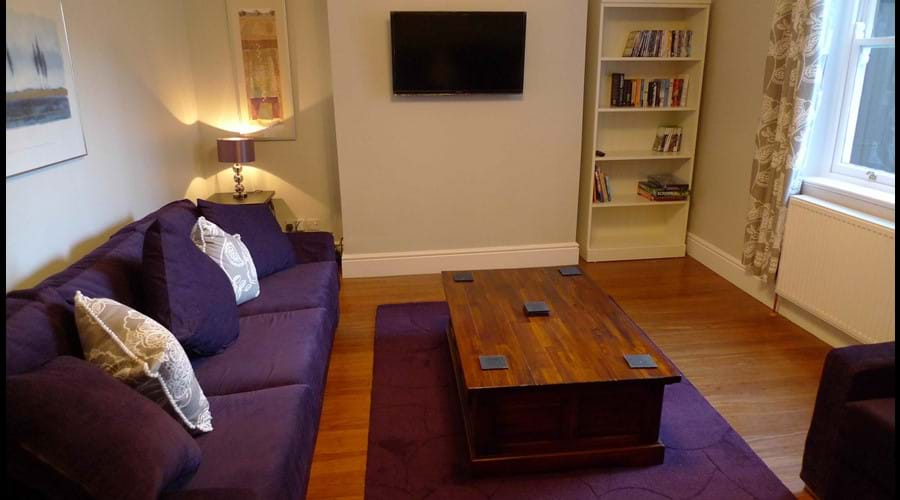 2nd Reception with flatscreen wall mounted TV, X Box, small collection of DVDs, books and board games