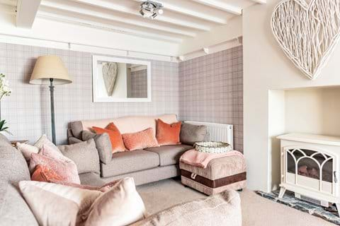 Lounge with seating for six, Smart TV and log burner effect stove