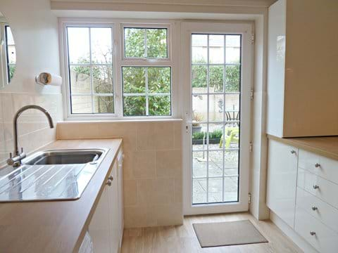 Fully equipped, newly fitted kitchen - direct access to garden & rear gate.