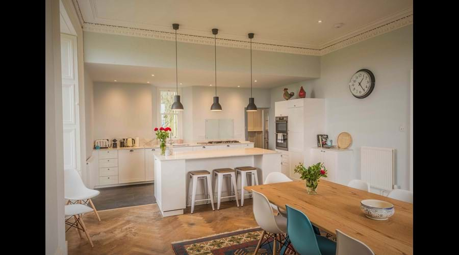 The kitchen island has 3 stools at it and so can become a popular spot for chopping n' chatting!