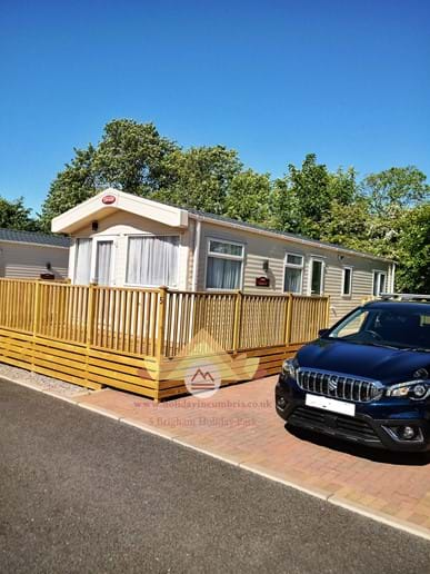 Parking Space for No. 5 is to right of Caravan in front of Decking Steps