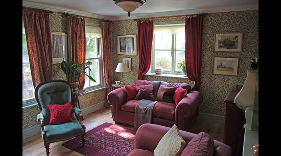 Albion Cottage living room with bed settee