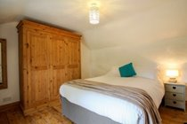 Bedroom with King size bed and large three door wardrobe