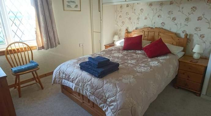 bedroom with double bed and plenty of space to properly unpack