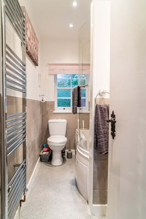 The brand new bathroom is compact but luxurious