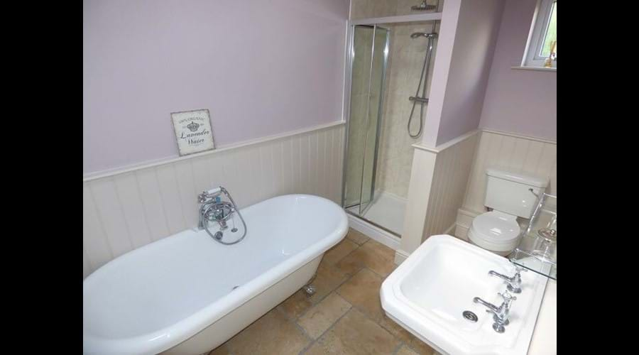 Luxury bathroom with rolltop bath and walk in shower