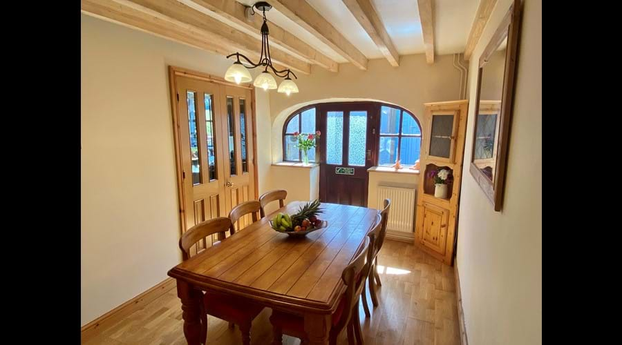 Trysor Holiday Cottage Dining Room coach door aspect.