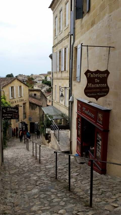 St Emilion old cobbled steep street with small wine shops