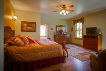 "Relax in luxury in the ""Moose Roost"" master suite"