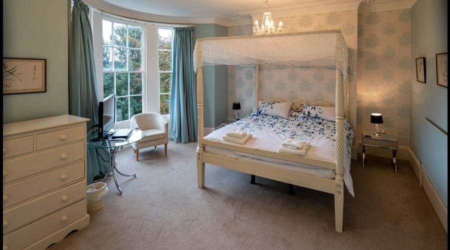 First floor Master Bedroom with superking 4 poster, TV, ensuite shower room.