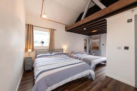 The bedroom can sleep four