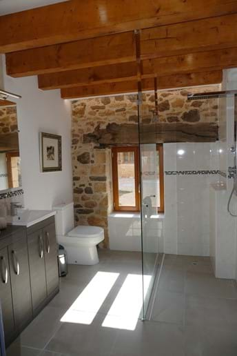 En suite for Bedroom One has a walk-in rain shower