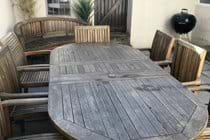 Patio garden with table seating 8, barbecue and bench
