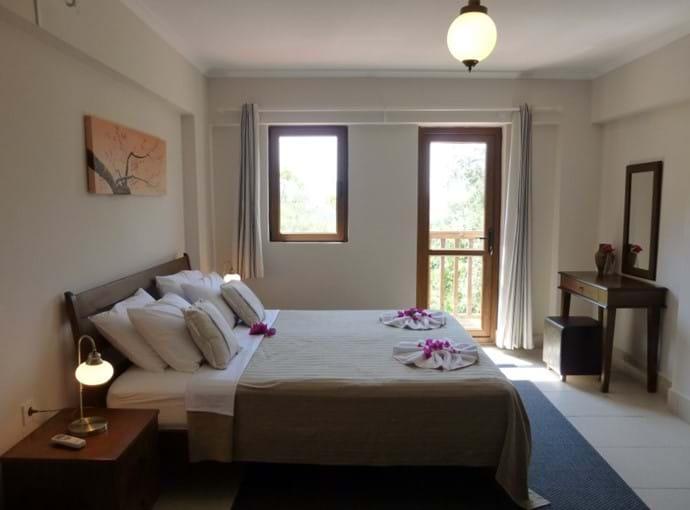 Master bedroom, en-suite and balcony