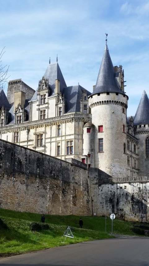 Rochefoucaud castle which is white with grey pointed turrets