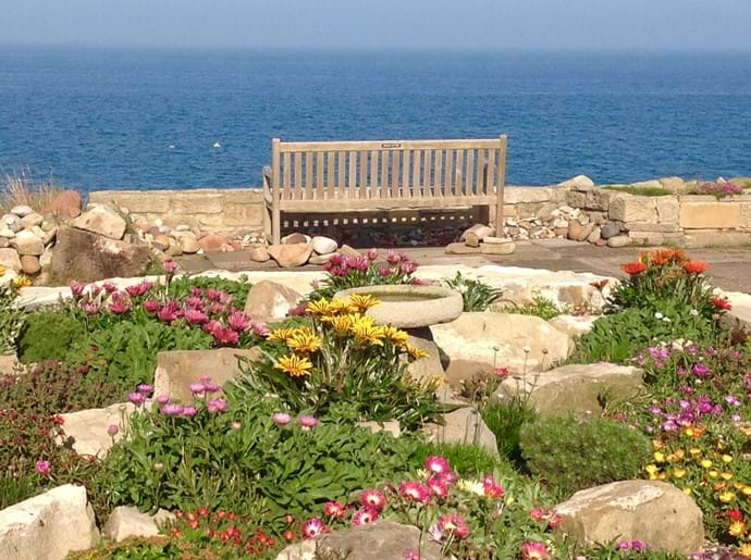 There is a pretty rock garden at the rear, full of flowers in spring and summer