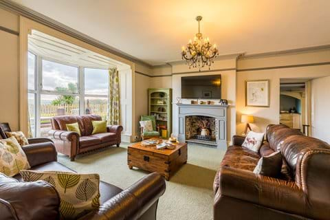 The the bright and airy family lounge with smart tv and far reaching countryside views (south facing).