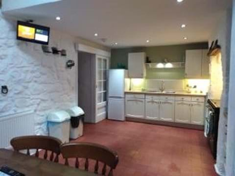 Large kitchen with original quarry tiled floor