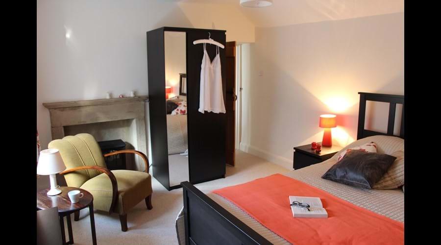 Bedroom 1, showing original stone fireplace