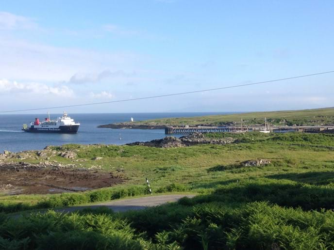 View of the ferry arriving on Colonsay from Glebe
