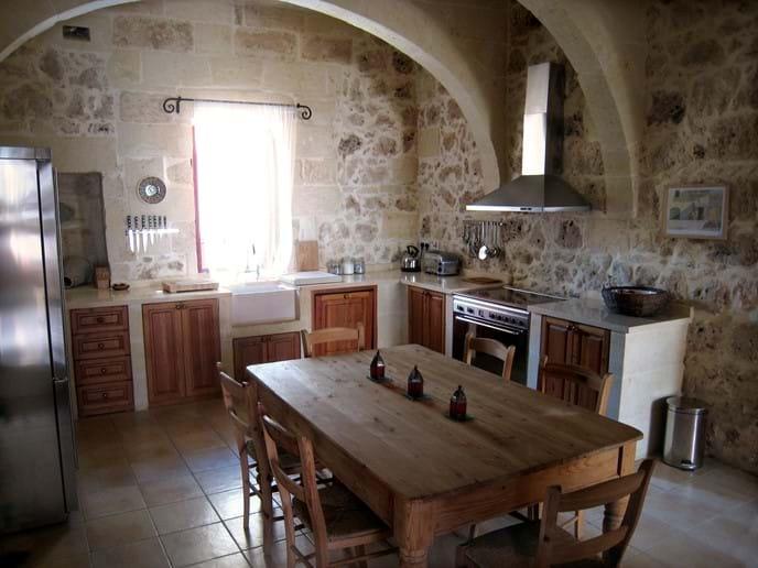 Kitchen with Limestone worktops, Smeg appliances and farmhouse table