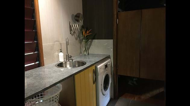 Modern laundry with 5kg front load washing machine.