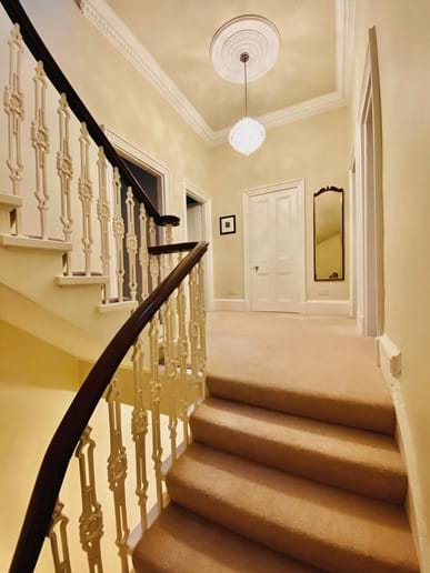 Large open staircase leading to first floor landing