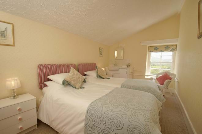 twin bedroom looking out over coarse and trout fishing lakes at Eisteddfa Fishery