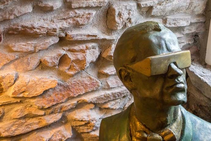 Bust of a man in cool sunglasses in Barnfield Holiday Cottage