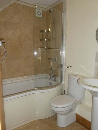 King size en-suite with full size bath and overhead shower