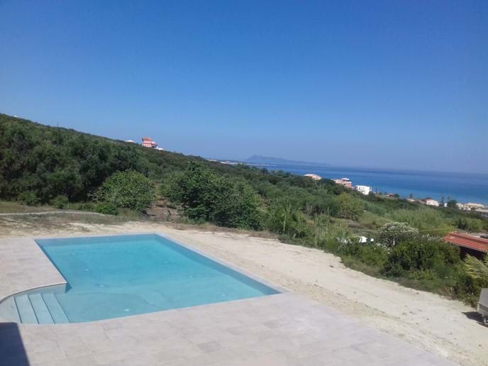 View of pool and Agios Stefanos bay