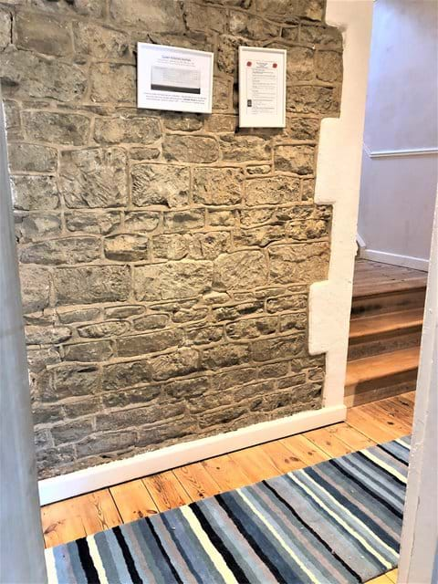 Exposed original stone walls in the hall
