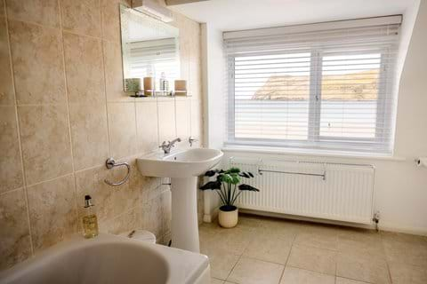 Large family bathroom with bath and shower
