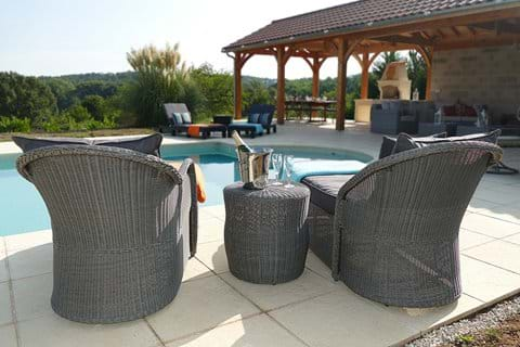 All weather rattan furniture around the pool