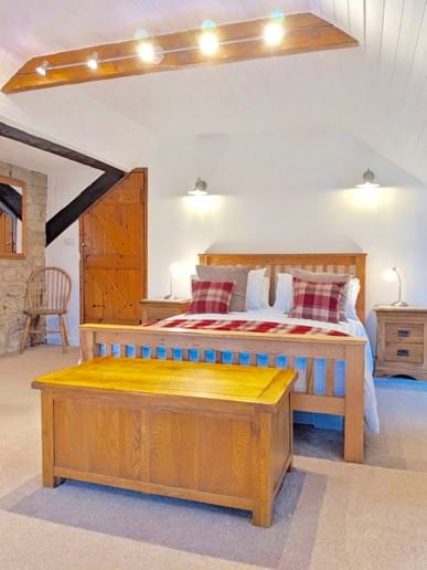 The master bedroom is enormous, with a king-sized bed, a sofa and a TV