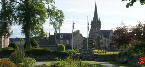 Forres seen from the sunken garden at the entrance to Grant Park