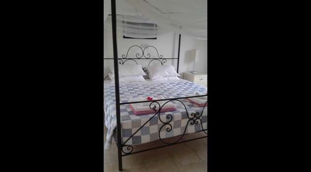 Master bedroom with four poster superking sized bed