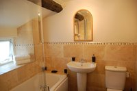 Newly fitted bathroom with original beam