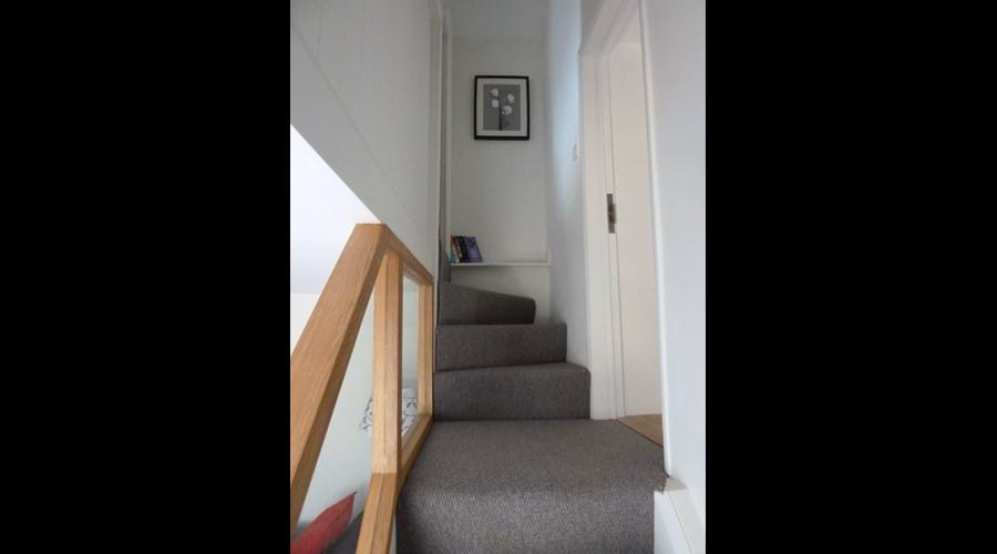 Bottom stairs looking up from sitting room
