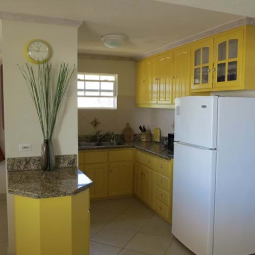 This modern fully equipped kitchen in Seawinds property rental.