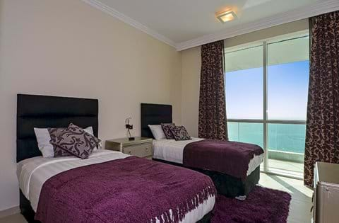 """""""Bedroom 3 with full sea views! Enjoy a restful night's sleep in the twin Sweet Dreams beds """""""