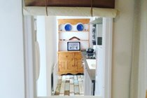 Internal window between kitchen and interior hall, Chapel Bay Lodge