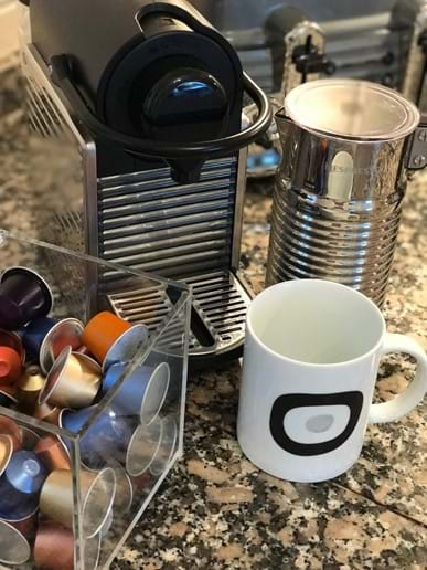 Nespresso, Aeroccino, and coffee mugs